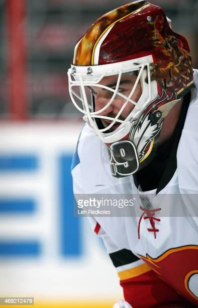Reto Berra of the Calgary Flames looks on against the Philadelphia Flyers on February 8 2014 at the Wells Fargo Center in Philadelphia Pennsylvania