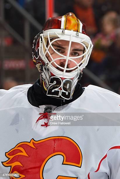 Reto Berra of the Calgary Flames looks on against the Philadelphia Flyers at the Wells Fargo Center on February 8 2014 in Philadelphia Pennsylvania