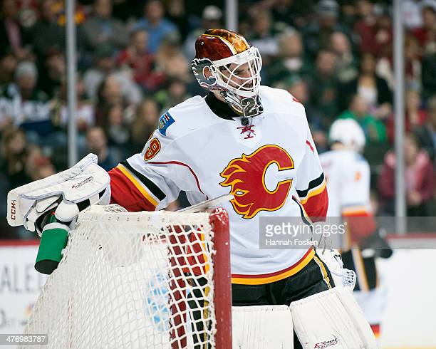 Reto Berra of the Calgary Flames looks on during the game against the Minnesota Wild on March 3 2014 at Xcel Energy Center in St Paul Minnesota