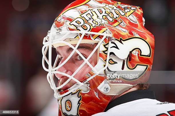 Reto Berra of the Calgary Flames looks on from his crease during their NHL game against the Vancouver Canucks at Rogers Arena January 18 2014 in...