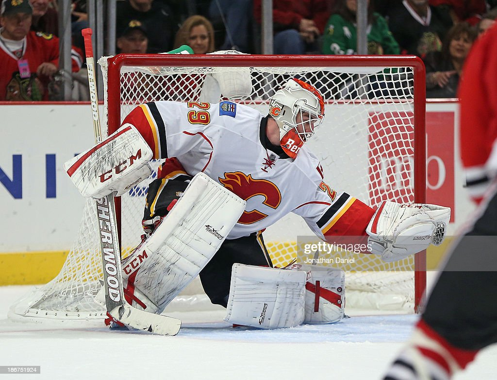 Reto Berra #29 of the Calgary Flames makes a glove save in the third period in his NHL debut against the Chicago Blackhawks at the United Center on November 3, 2013 in Chicago, Illinois. The Flames defeated the Blackhawks 3-2 in overtime.