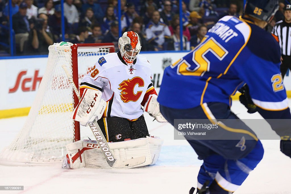 Reto Berra #29 of the Calgary Flames makes a save against the St. Louis Blues at the Scottrade Center on November 7, 2013 in St. Louis, Missouri. The Blues beat the Flames 3-2.