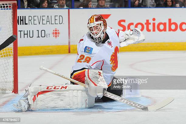 Reto Berra of the Calgary Flames makes a save in a game against the Edmonton Oilers on March 1 2014 at Rexall Place in Edmonton Alberta Canada