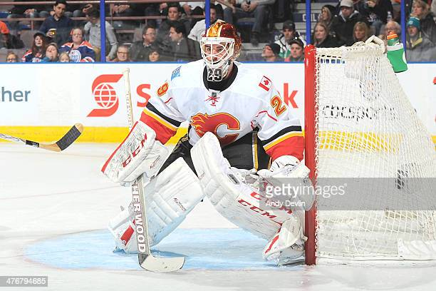 Reto Berra of the Calgary Flames prepares to make a save in a game against the Edmonton Oilers on March 1 2014 at Rexall Place in Edmonton Alberta...