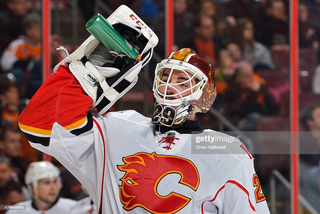 Reto Berra of the Calgary Flames takes a drink against the Philadelphia Flyers at the Wells Fargo Center on February 8 2014 in Philadelphia...