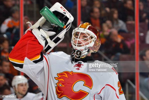 Reto Berra of the Calgary Flames takes a drink against the Philadelphia Flyers at the Wells Fargo Center on February 8 2014 in Philadelphia...