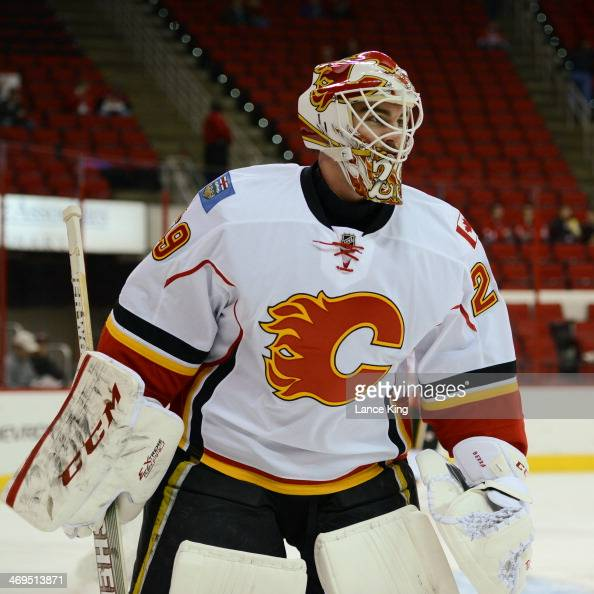 Reto Berra of the Calgary Flames warms up prior to a game against the Carolina Hurricanes at PNC Arena on January 13 2014 in Raleigh North Carolina