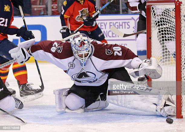 Reto Berra of the Colorado Avalanche makes a stop during a game against the Florida Panthers at BBT Center on October 27 2015 in Sunrise Florida