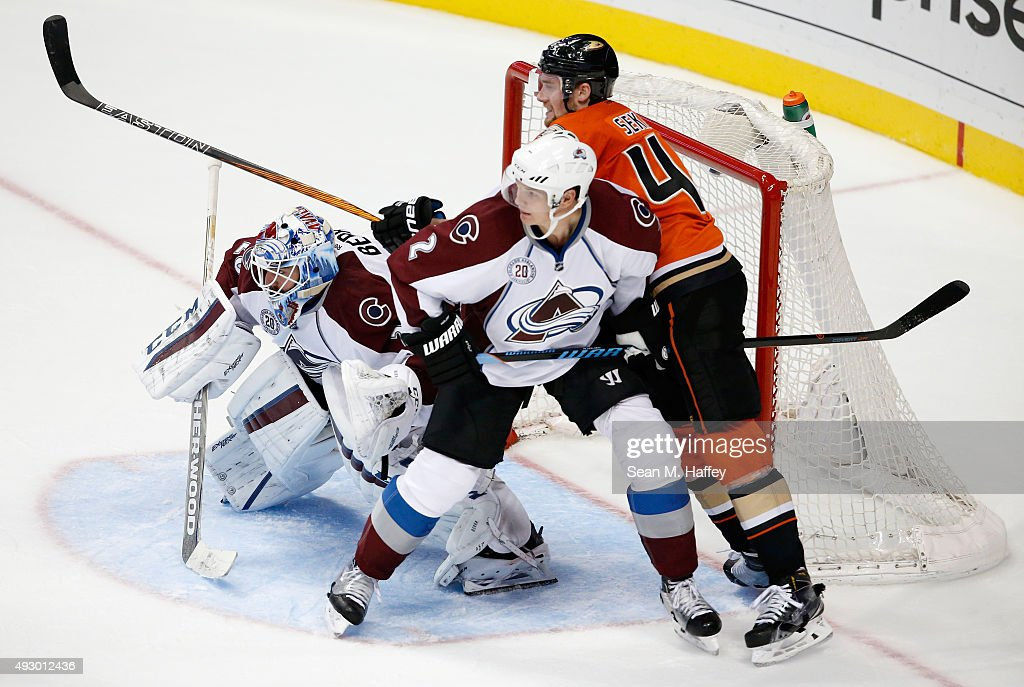 Reto Berra #20 of the Colorado Avalanche, Nick Holden #2 of the Colorado Avalanche, and Jiri Sekac #46 of the Anaheim Ducks battle for position during the third period of a game at Honda Center on October 16, 2015 in Anaheim, California.