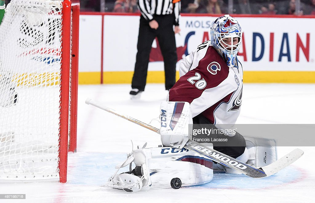 Reto Berra of the Colorado Avalanche stops a shot by the Montreal Canadiens in the NHL game at the Bell Centre on November 14 2015 in Montreal Quebec...