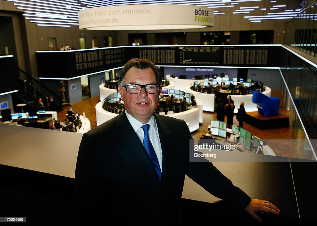 <a gi-track='captionPersonalityLinkClicked' href=/galleries/search?phrase=Reto+Francioni&family=editorial&specificpeople=619017 ng-click='$event.stopPropagation()'>Reto Francioni</a>, chief executive officer of Deutsche Boerse AG, poses for a photograph in front of the trading floor of the Frankfurt Stock Exchange following a news conference to announce the company's annual full year results, in Frankfurt, Germany, on Thursday, Feb. 20, 2014. Deutsche Boerse AG plans to set up a clearinghouse in Singapore to compete with Singapore Exchange Ltd. and IntercontinentalExchange Group Inc. as the owner of the Frankfurt Stock Exchange and the Eurex futures market seeks to benefit from new financial regulations. Photographer: Ralph Orlowski/Bloomberg