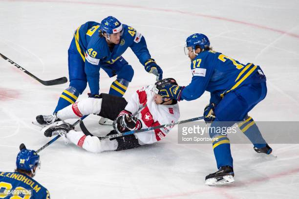 Reto Schappi vies with Victor Hedman and Victor Rask during the Ice Hockey World Championship Quarterfinal between Switzerland and Sweden at...