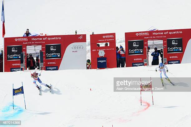 Reto Schmidiger of Switzerland competes against Anton Lahdenperae of Sweden during the Audi FIS Alpine Ski World Cup Finals Nations Team Event on...