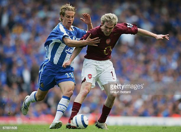 Reto Ziegler of Wigan Athletic challenges Alexander Hleb of Arsenal during the Barclays Premiership match between Arsenal and Wigan Athletic at...