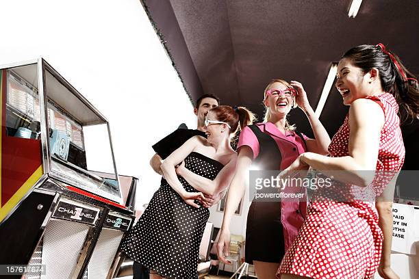 Retro 1950's Friends Dancing by the Jukebox in Soda Shop