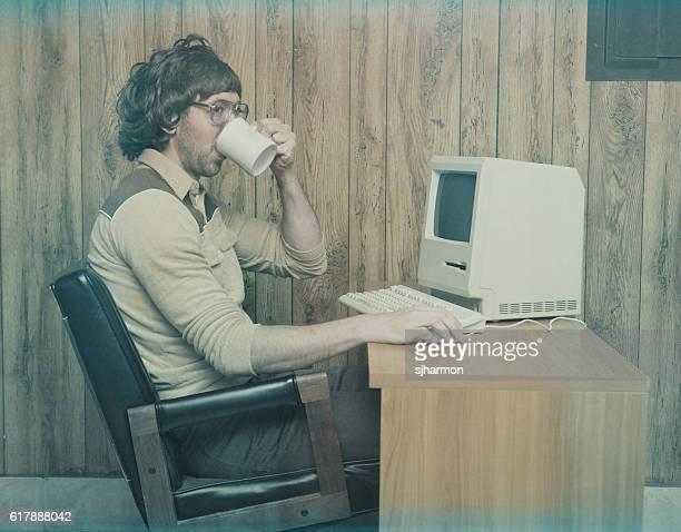 Retro 1980s computer worker drinking coffee