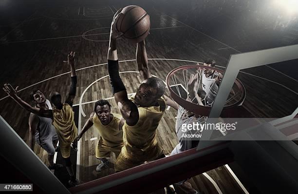 A retro action shot of an intense basketball game moment