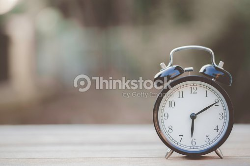 Retro Alarm Clock On Wooden Table Vintage Style Stock Photo Thinkstock