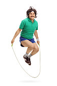 Vertical shot of a retro athlete exercising with a skipping rope isolated on white background