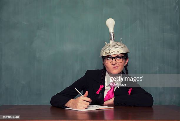 Retro Businesswoman with Thinking Cap is Confused