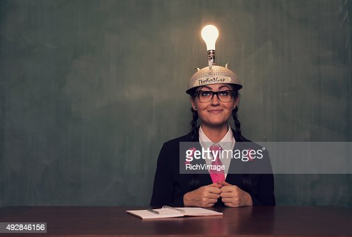 Retro Businesswoman with Thinking Cap is Happy