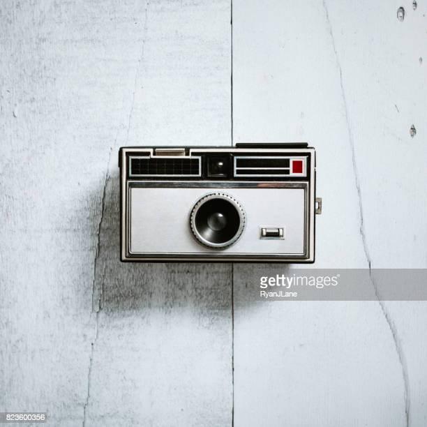 Retro Camera on Wood Background