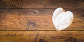Old style Valentine's Day cad and idea, love letter, love symbol, painted wooden hart isolated on antique oak panels - top view