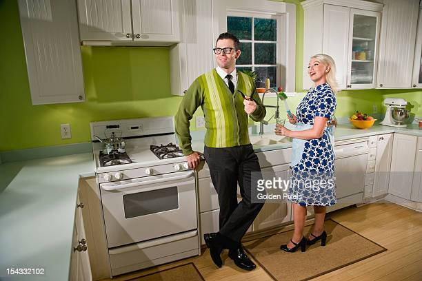 Retro couple at home in kitchen chatting