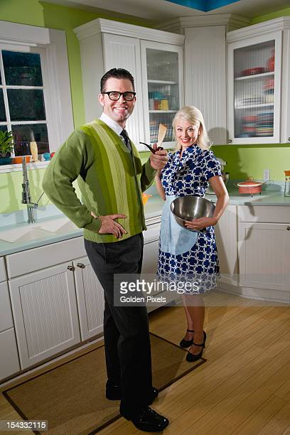 Retro couple at home in kitchen