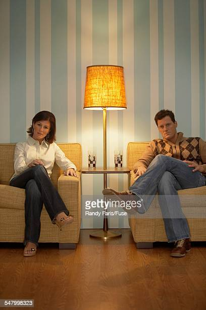 Retro Couple Sitting Side By Side
