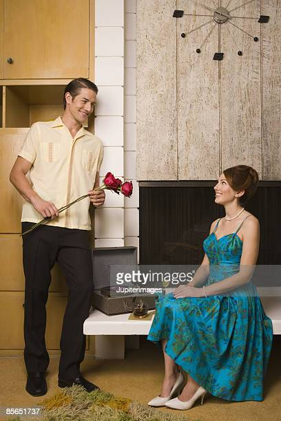 Retro couple with roses and cocktails