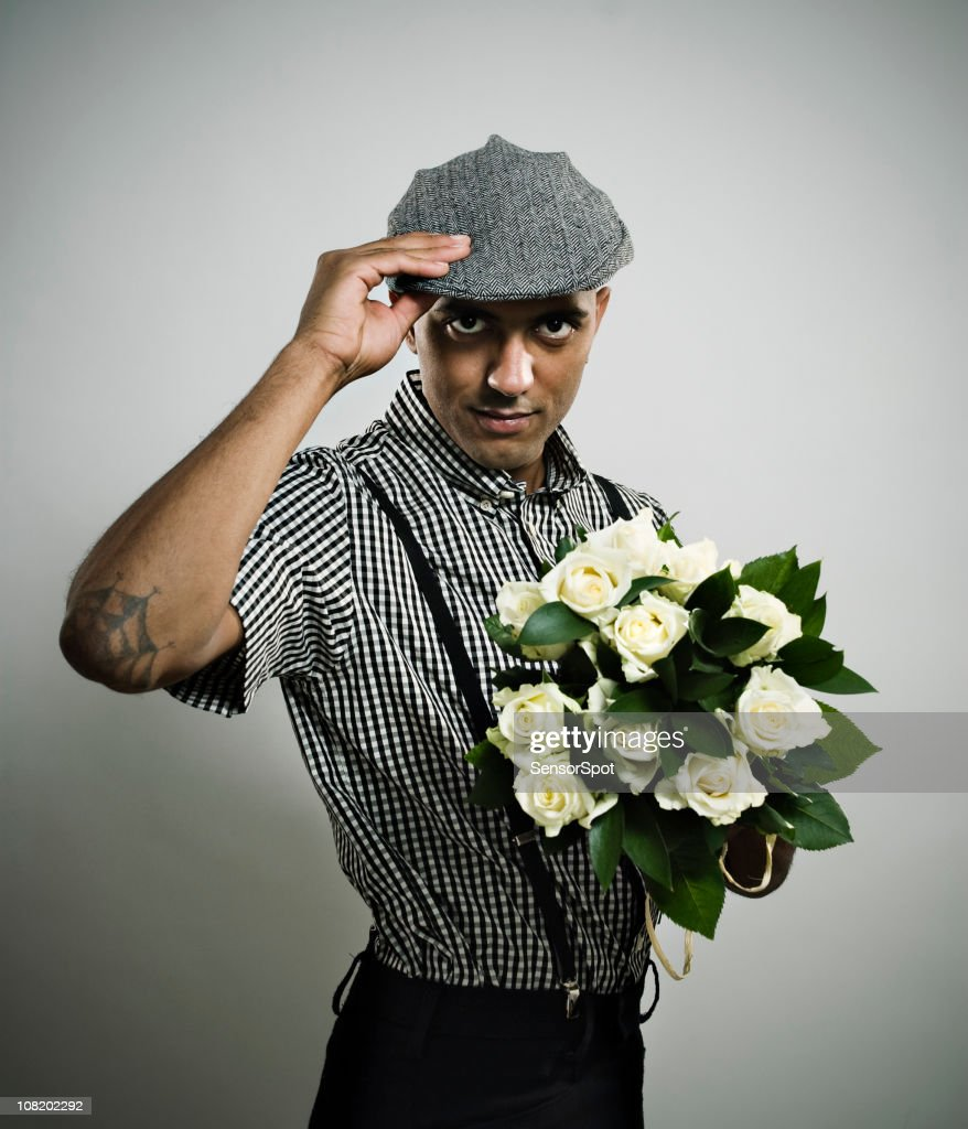 Retro Dressed Man Holding Bouqet of Flowers : Stock Photo