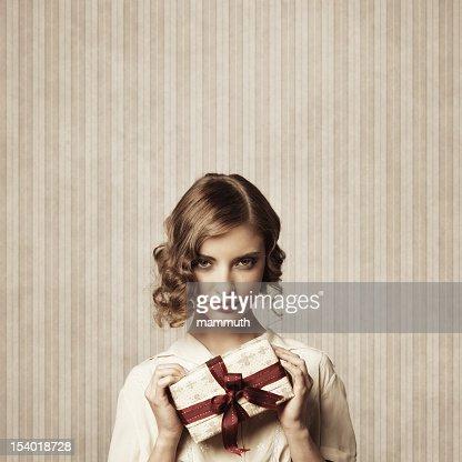 retro girl holding christmas gift : Stock Photo