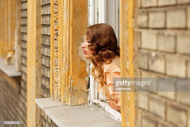 retro girl looking out of the window