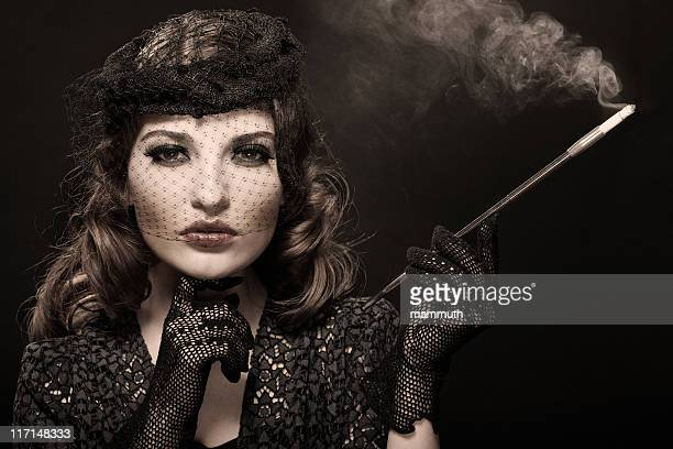Retro girl with cigarette holder