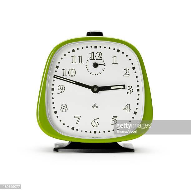 Retro green alarm clock. Isolated Old fashioned Time