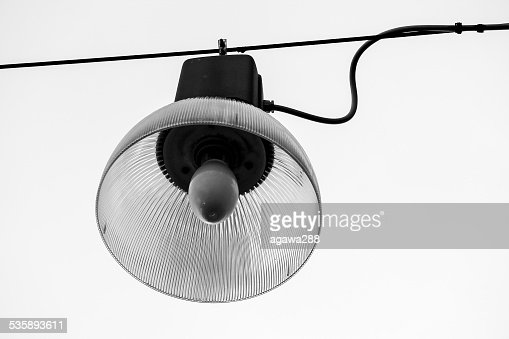 Retro hanging street lamp. Isolated on white. Black and white : Stock Photo
