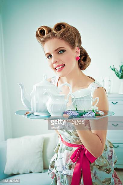 Retro housewife serving coffee
