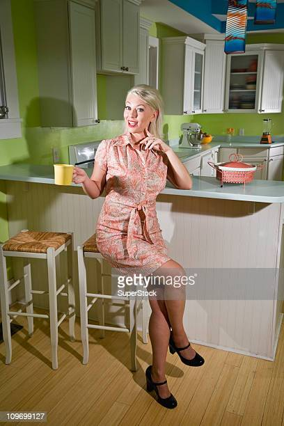 Retro housewife sitting in kitchen taking a break