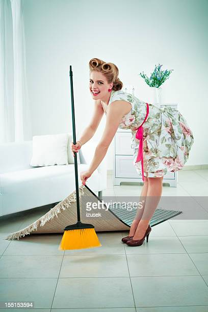 Retro housewife sweeping