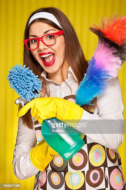 Retro housewife with cleaning utensils