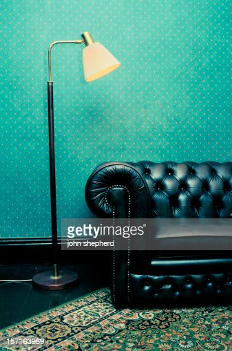 retro leather couch with light shining over it cross processed stock. Black Bedroom Furniture Sets. Home Design Ideas
