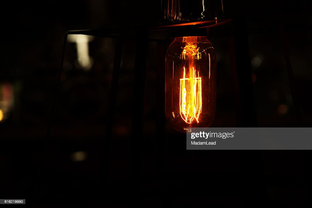 retro light bulb in the dark background at night : Stock Photo