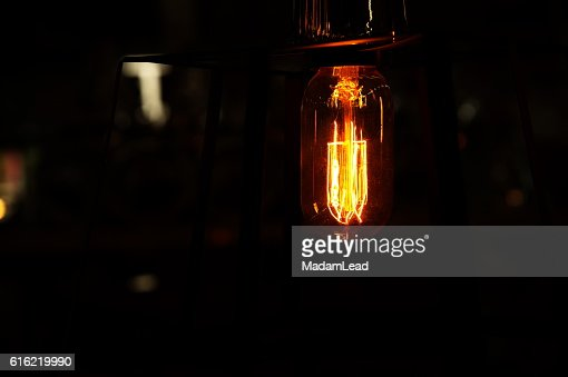 retro light bulb in the dark background at night : Bildbanksbilder