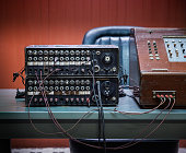 1950s manual telephone switchboard with sockets and cables