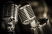 closeup of chromed retro recording studio microphones