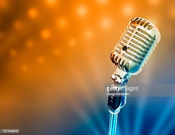 Retro microphone in front of brightly lit stage