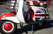 A brightly painted retro motor scooter in British colours.