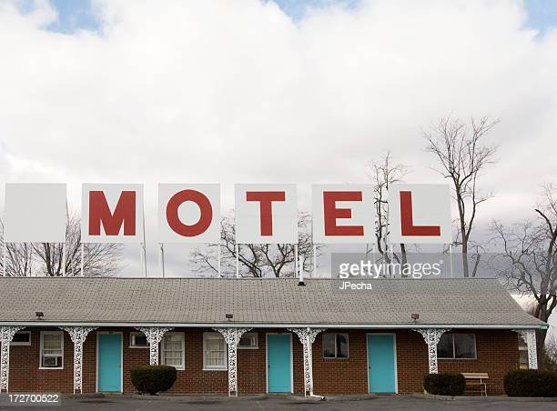 Retro Red Lettered Motel Sign on top of building