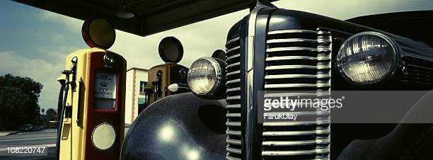 Retro Scene with Vintage Gas Pumps and Car